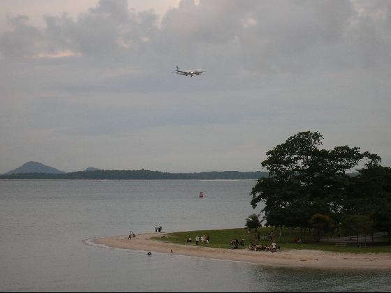 3476085-Check_Out_Approaching_Planes_Changi_Beach_Park